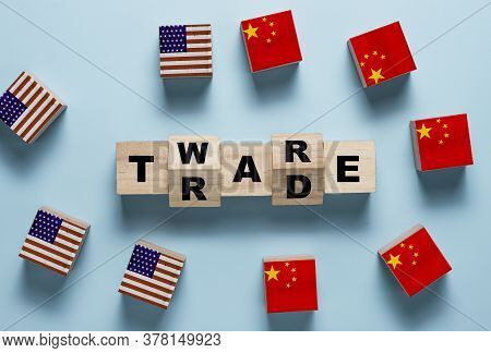 Trade War Wording On Wooden Cubes Block With Usa And China Flag.it Is Symbol Of Economic Tariffs Tra
