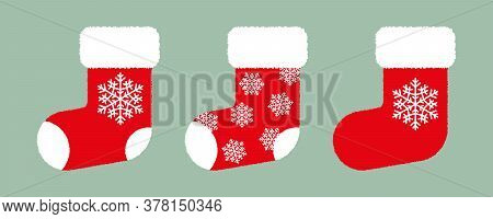 Set Of Red Fluffy Christmas Stockings With White Snowflakes On Green Background. Vector Christmas Gi