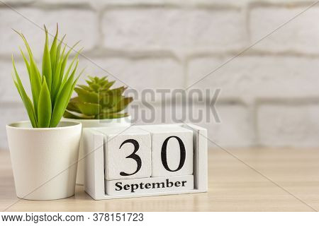 September 30 On A Wooden Calendar On A Table Or Shelf.one Day Of The Autumn Month.calendar For Septe