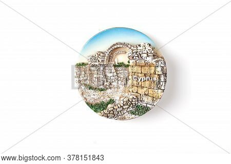 Cyprus Tourist Souvenir Isolated On White. Round Souvenir With Depiction Of Ancient Architecture.
