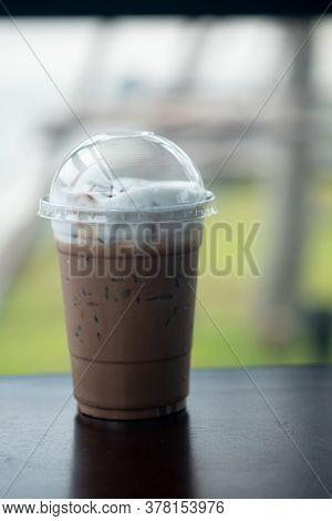 Iced Mocha Coffee With Milk Cream On Top In Takeaway Cup At Coffee Shop.