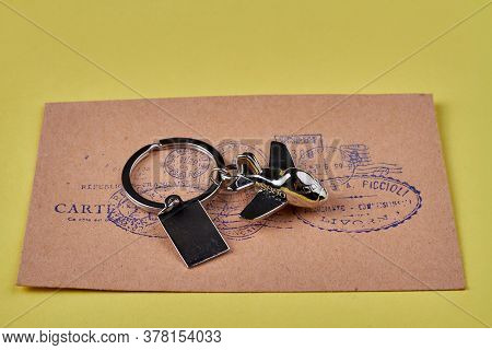 Envelope Delivery Concept. International Correspondence Concept. Metal Toy Plane Trinket And Letter