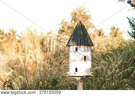 Birdhouses And Bird Feeder. White Wooden Outdoor Garden Birds Wood Nesting House Nest Home In Garden