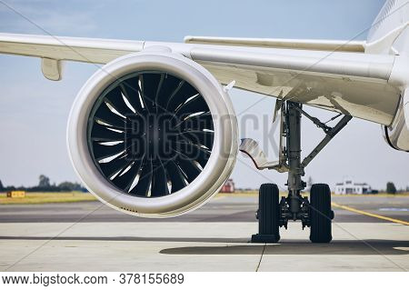 Jet Engine Of Commercial Airplane At Airport During Sunny Day. Themes Modern Technology, Power And T