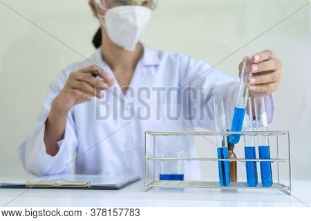 Scientist Wear Lab Coat And Protective Wear Are Working With Research Or Doing Investigations With T