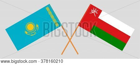 Crossed Flags Of Oman And Kazakhstan. Official Colors. Correct Proportion. Vector Illustration