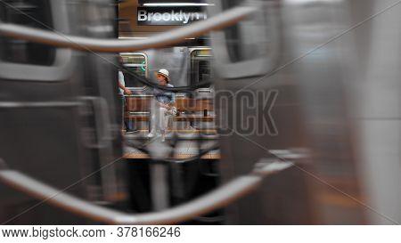 Young girl at the subway station, NYC