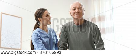 Care Worker Helping Elderly Man In Geriatric Hospice. Banner Design