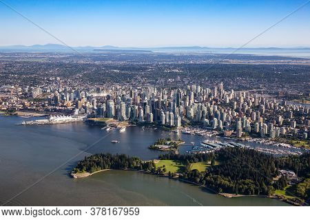 Downtown Vancouver, British Columbia, Canada. Aerial View Of Stanley Park, Coal Harbour And Modern U