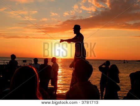 Street performer performs in the sunset at Mallory Square in Key West Fla. poster