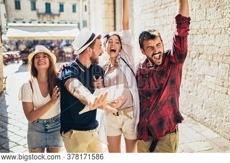 Appy Group Of Tourists Traveling And Sightseeing