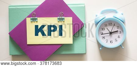 Colored Notepads, Alarm Clock And Sticker With Kpi Text On White Background