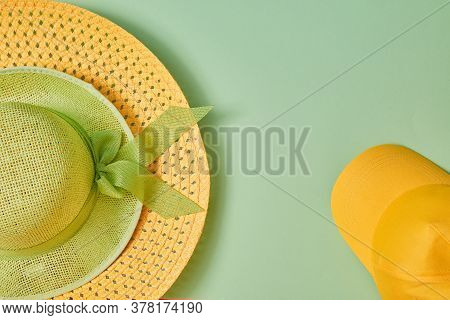 Straw Hat With Bow And Bright Yellow Cap. Headwear. Summer Holidays. Female Accessory. Copy Space. G