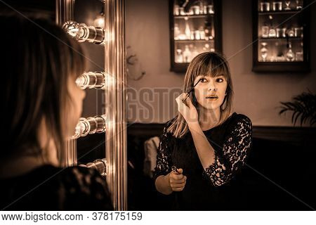Woman Looking Into A Vintage Mirror At Herself And Use Cosmetic Vanity Make Up Eye, Makeup Dressing