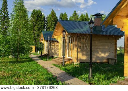 Wooden Houses Located On The Lake Shore Are Used For Outdoor Picnics With Family Or Friends.