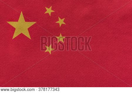 National Emblem Of The Peoples Republic Of China . Flag Of China On Close Up. Red Flag With Stars.