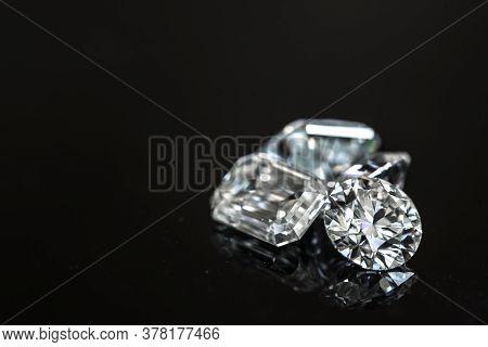 Diamonds On Black Background. Various Shapes Of Gemstones
