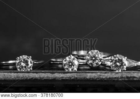 Precious Diamond Rings On The Black Background