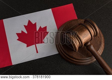 Judge Gavel On Canada Flag . Canadian Legislation. Law And Justice