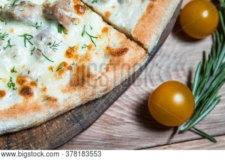 Appetizing Pizza On A Wooden Table Surrounded By Herbs And . The Concept Of Delicious Food, Restaura