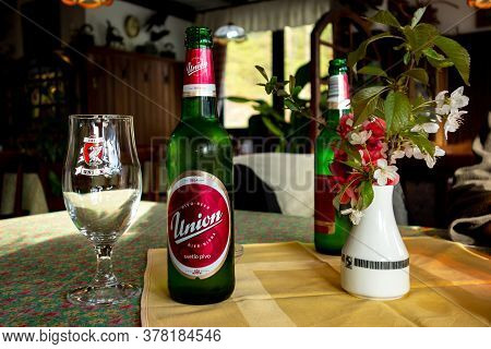 Ribcev Laz, Slovenia - April 19, 2014: The Green Bottle Of Union Beer With An Empty Glass And A Flow