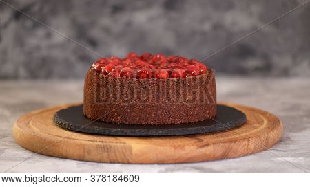 Delicious Homemade Chocolate Cheesecake Decorated With Cherry Sauce.
