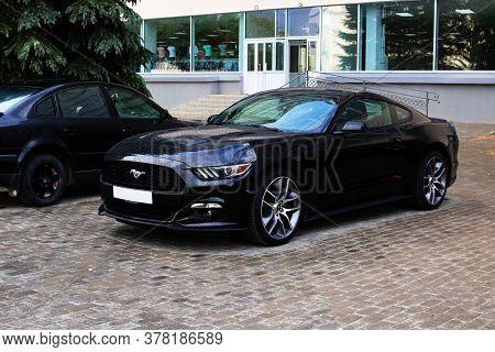 Belarus, Novopolotsk - July 23, 2020: Black Ford Mustang Car In Parking Lot