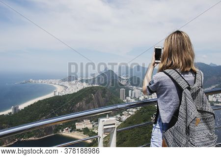 Rio De Janeiro; Brazil - February, 12, 2019: Female Tourist Taking A Mobile Photo Of Copacabana Beac