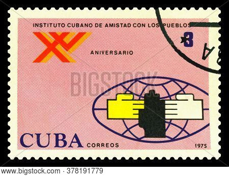 Stavropol, Russia - July 25. 2020: A Stamp Printed In The Cuba Shows  15 Th Anniv.  Peoples Friendsh