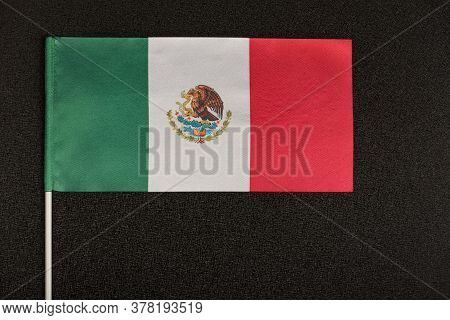 Table Flag Of Mexico On Black Background. Striped Tricolor Green White Red.