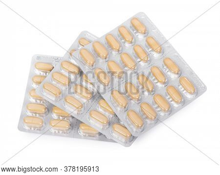 Yellow pills in a blister pack isolated on white background