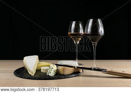 French Cheese And Wine. Rosé And Bourgogne In Glasses. Cheese Board