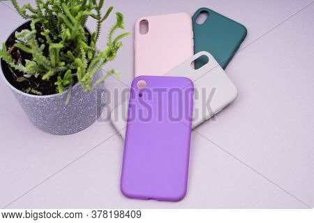 A Few Silicone Cases For The Smartphone. Purple, Grey, Green And Pink Smartphone Cases. Protect Your