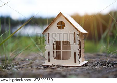 Miniature Wooden House Outdoor Nature. Real Estate Concept. Modern Housing. Eco-friendly Energy Effi