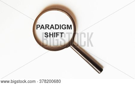 Paradigm Shift On A Sheet Under A Magnifying Glass