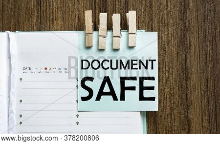 Document Safe Notes Paper And A Clothes Pegs On Wooden Background