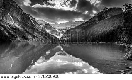 Black And White Photo Of Lake Louise In The Rocky Mountains In Banff National Park, Alberta, Canada