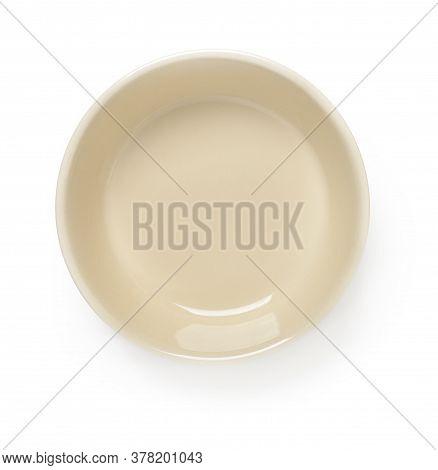 Empty Beige Ceramic Bowl Or Ramekin Isolated On A White Background. Empty Crockery For Food Design.