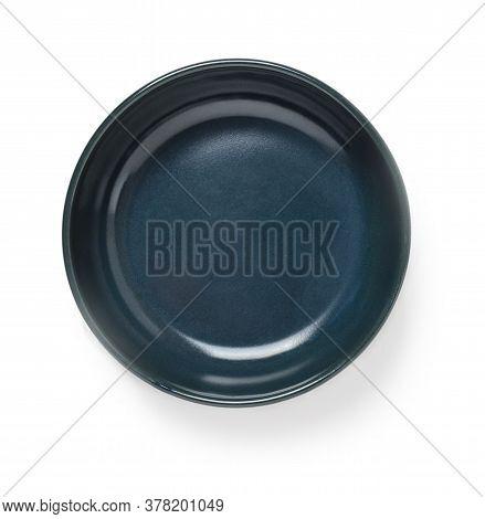Empty Dark Blue Ceramic Bowl Or Ramekin Isolated On A White Background. Empty Crockery For Food Desi