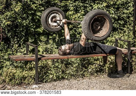 Muscular Man Working Out Tire Flip, Outdoor. Strong Male Crossfit Training