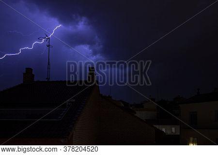 Lighting Bolt On A Rainy Night On The City