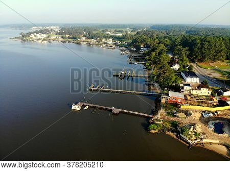 Millsboro, Delaware, U.s.a - July 26, 2020 - The Aerial View Of The Waterfront Home With Private Doc