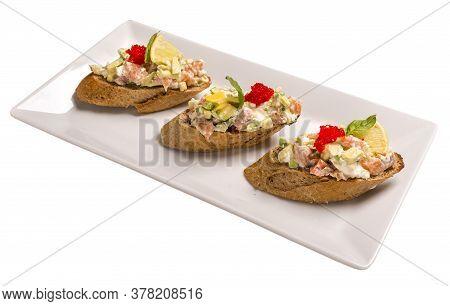 Bruschetta With Salmon And Avocado Dried Rye Baguette, Cream Cheese, Salmon, Tobiko Caviar, Avocado,