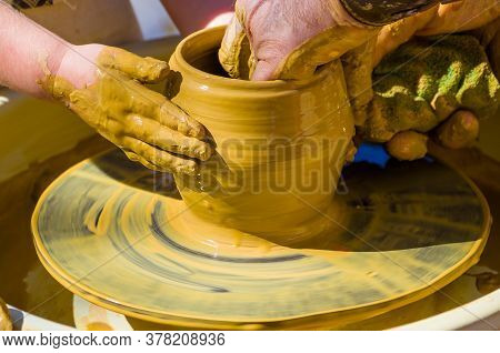 Hands Of The Skilled Master Potter And Childrens Hands, Training Of The Kid To Production Of Pottery