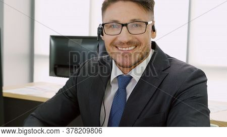 Business People Wearing Headset Working In Office To Support Remote Customer Or Colleague. Call Cent