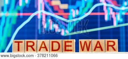 Trade War. Wooden Blocks With The Inscription Trade War On The Background Of The Stock Chart