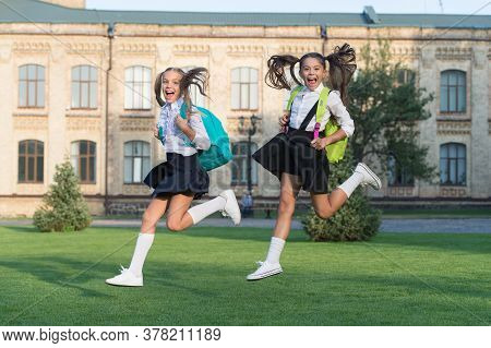 Excited Happy Girls School Uniform Running, Hurry Up Concept.