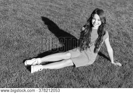 Vacation Ideas. Happy Smiling Girl Enjoy Relax On Lawn. Cheerful Schoolgirl. Have Fun. Girl Cute Kid