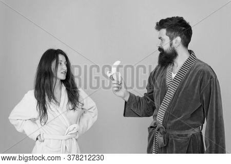 Healthy Breakfast. Couple Sleepy Faces Domestic Clothes Eat Banana. Couple In Love Bathrobes. Advice