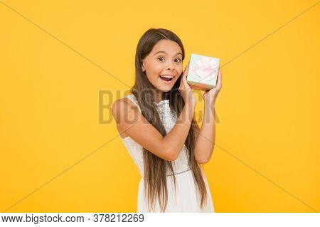 Something Special. Perfect Package. Child Happy Face Holds Big Gift Box Yellow Background. Kid Girl